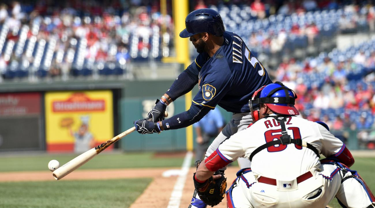 Milwaukee Brewers' Jonathan Villar hits an RBI-single off Philadelphia Phillies starting pitcher Jeremy Hellickson to score Domingo Santana during the fourth inning of a baseball game, Saturday, June 4, 2016, in Philadelphia. (AP Photo/Derik Hamilton)