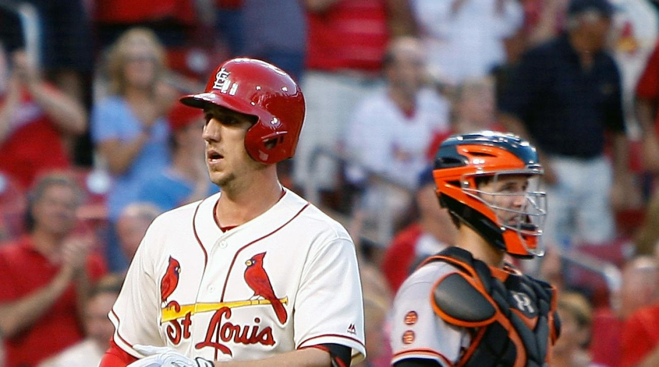 San Francisco Giants catcher Buster Posey, right, looks on as St. Louis Cardinals' Stephen Piscotty crosses home plate after hitting a solo home run during the sixth inning of a baseball game Saturday, June 4, 2016, in St. Louis. (AP Photo/Scott Kane)