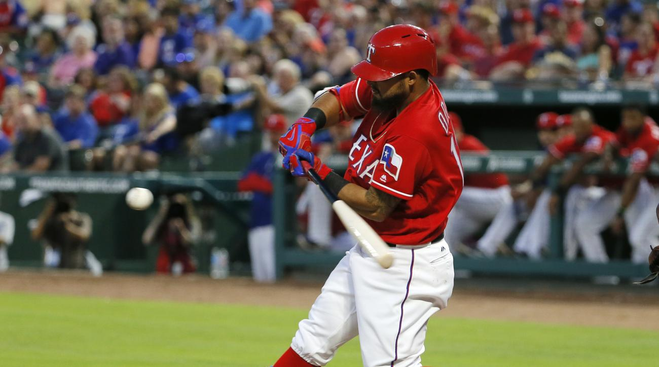 Texas Rangers' Rougned Odor swings at a pitch from Seattle Mariners' Nathan Karns that he singled in the first inning of a baseball game on, Saturday, June 4, 2016, in Arlington, Texas. (AP Photo/Tony Gutierrez)