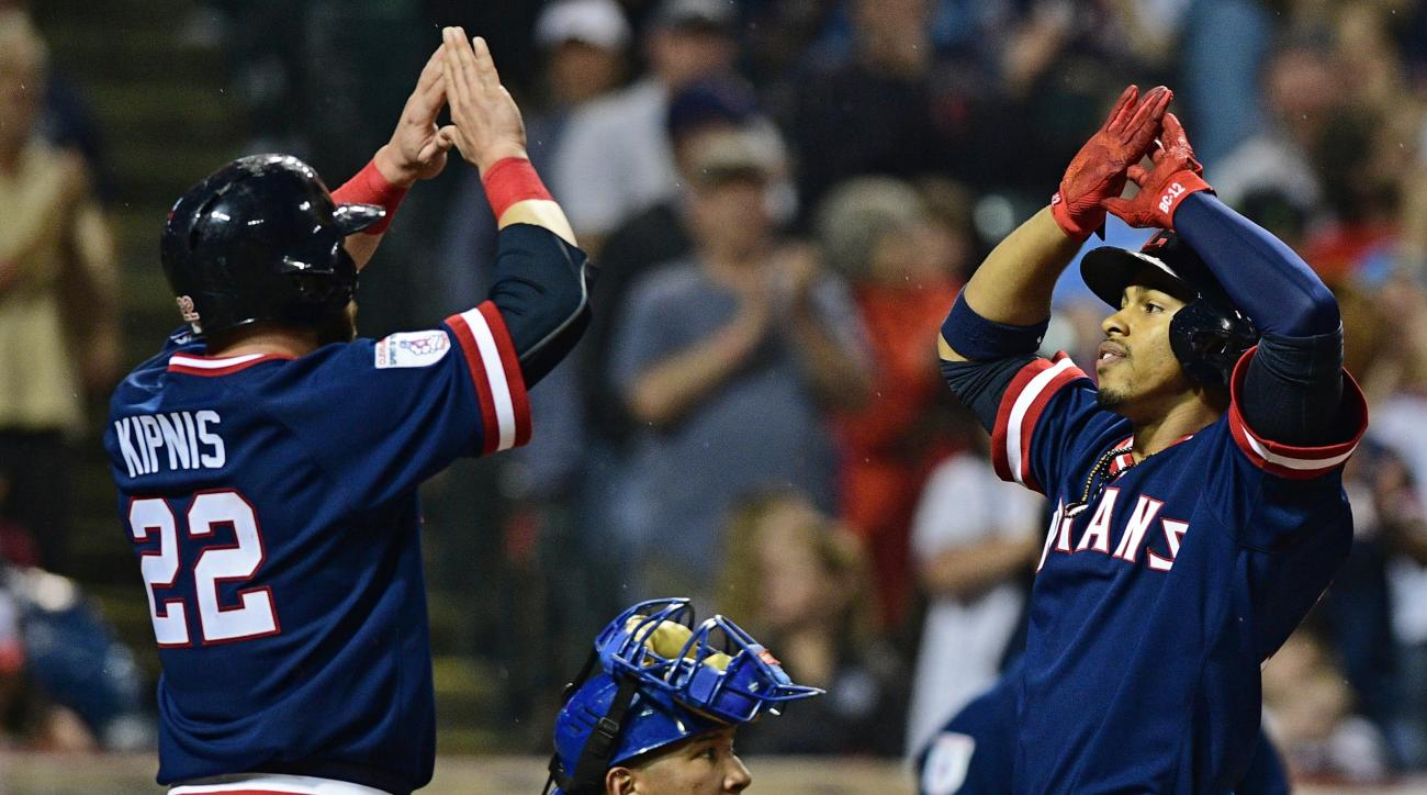 Cleveland Indians' Jason Kipnis, left, congratulates Francisco Lindor, right, after Lindor hit a two-run home run in the seventh inning of a baseball game against the Kansas City Royals, Saturday, June 4, 2016, in Cleveland, Ohio. (AP Photo/David Dermer)