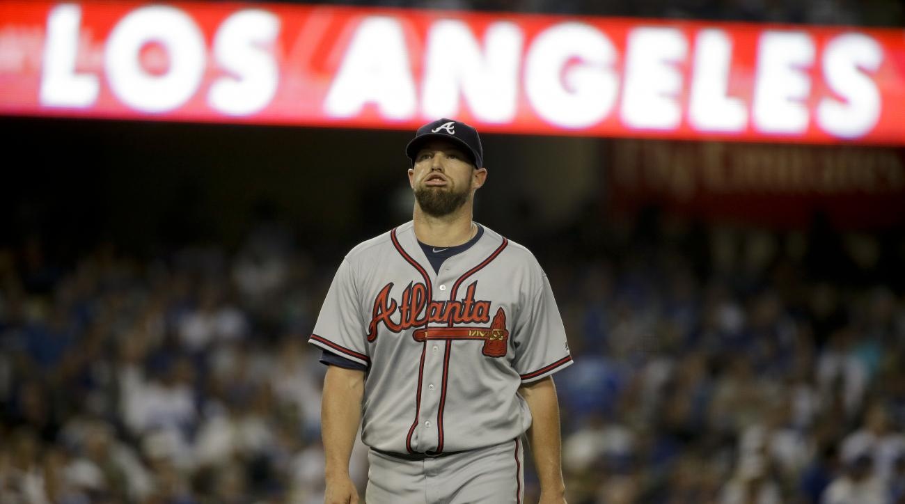 Atlanta Braves starting pitcher Bud Norris reacts after giving up a run during the third inning of a baseball game against the Los Angeles Dodgers in Los Angeles, Saturday, June 4, 2016. (AP Photo/Chris Carlson)