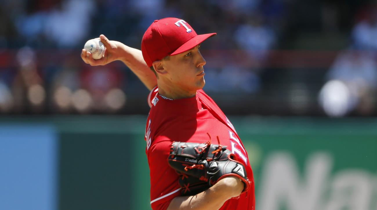 Texas Rangers starting pitcher Derek Holland (45) throws to the Seattle Mariners in the first inning of a baseball game, Sunday, June 5, 2016, in Arlington, Texas. (AP Photo/Tony Gutierrez)