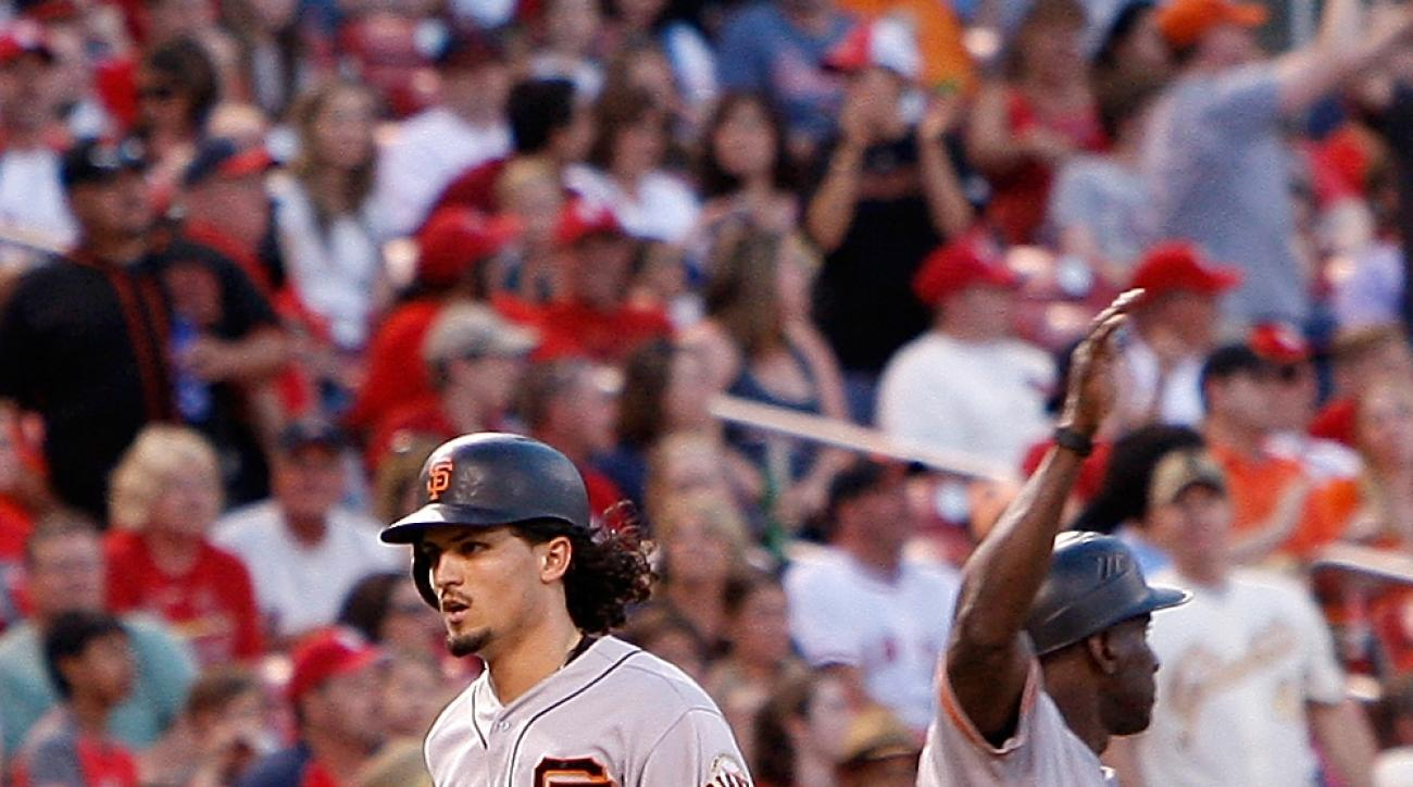 San Francisco Giants' Jarrett Parker runs past third base coach Roberto Kelly, right, after hitting a two-run home run during the fourth inning of a baseball game against the St. Louis Cardinals, Sunday, June 5, 2016 in St. Louis. (AP Photo/Scott Kane)