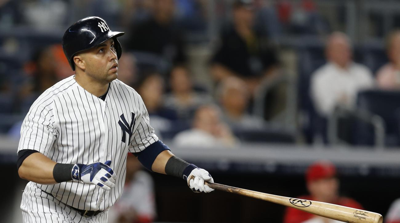 New York Yankees right fielder Carlos Beltran (36) watches his eight-inning, three-run home run clear the right field wall during a baseball game against the Los Angeles Angels at Yankee Stadium in New York, Monday, June 6, 2016. (AP Photo/Kathy Willens)