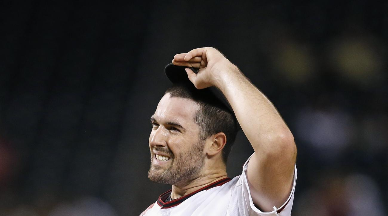 Arizona Diamondbacks' Robbie Ray grimaces after giving up a two-run home run to Tampa Bay Rays' Tim Beckham during the fifth inning of a baseball game Monday, June 6, 2016, in Phoenix. (AP Photo/Ross D. Franklin)