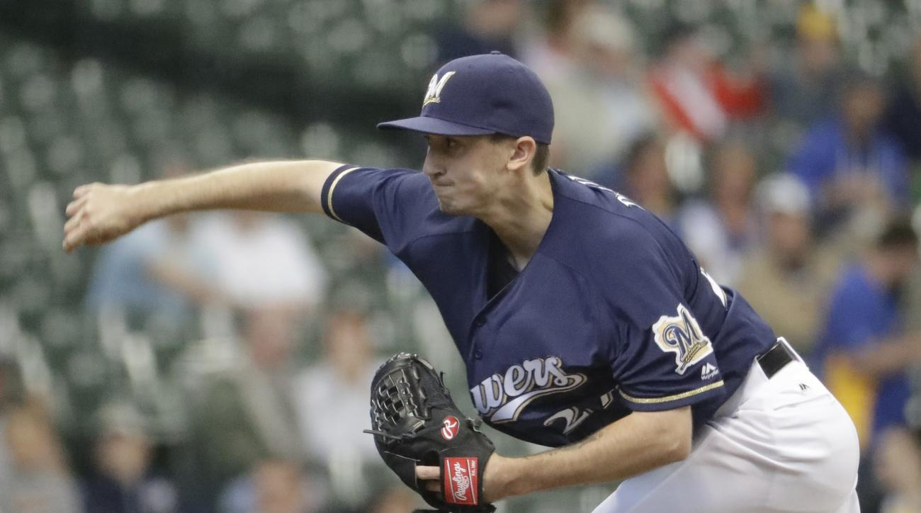 Milwaukee Brewers starting pitcher Zach Davies throws during the first inning of a baseball game against the Oakland Athletics Tuesday, June 7, 2016, in Milwaukee. (AP Photo/Morry Gash)