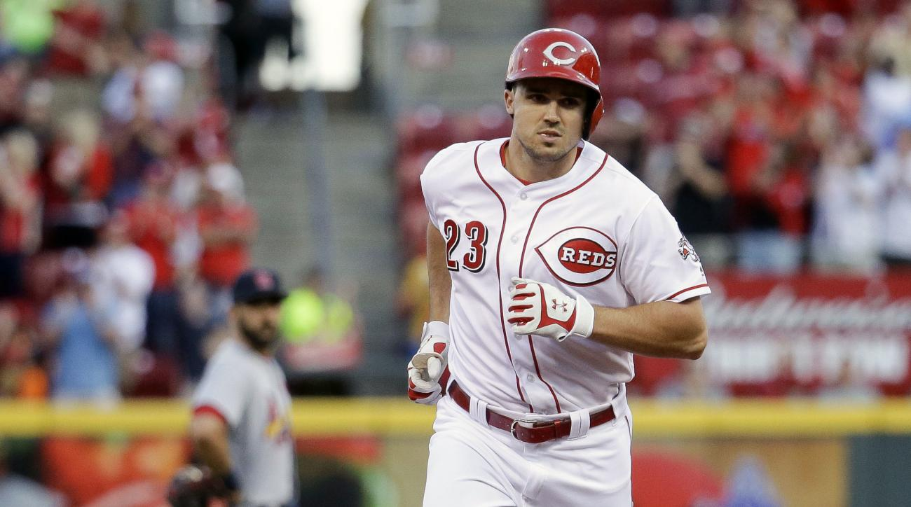 Cincinnati Reds' Adam Duvall runs the bases after hitting a three-run home run off St. Louis Cardinals starting pitcher Mike Leake in the fourth inning of a baseball game, Tuesday, June 7, 2016, in Cincinnati. (AP Photo/John Minchillo)