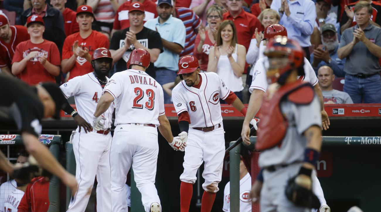 Cincinnati Reds' Adam Duvall (23) celebrates with Billy Hamilton (6) and Brandon Phillips (4) after hitting a three-run home run off St. Louis Cardinals starting pitcher Mike Leake (8) in the fourth inning of a baseball game, Tuesday, June 7, 2016, in Cin