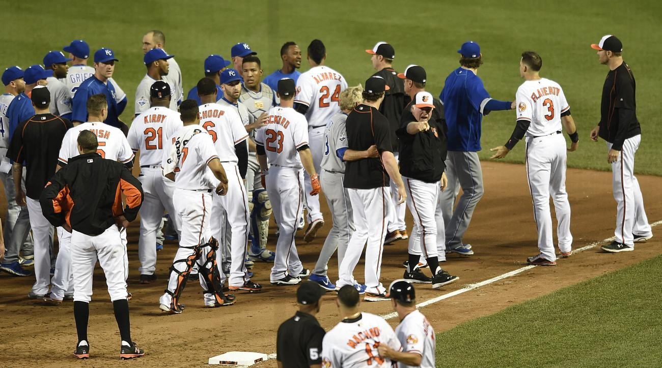 Baltimore Orioles manager Buck Showalter, right, calls to Manny Machado, foreground, after the benches cleared after Kansas City Royals pitcher Yordano Ventura threw a pitch at Machado in the fifth inning of a baseball game, Tuesday, June 7, 2016, in Balt