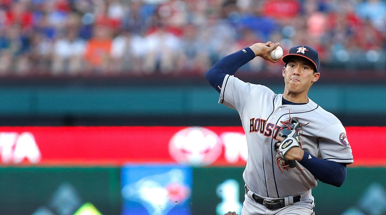Houston Astros shortstop Carlos Correa (1) throws to first to turn a double play after forcing out Texas Rangers' Jurickson Profar (19) during the third inning of a baseball game Tuesday, June 7, 2016, in Arlington, Texas. (AP Photo/Brandon Wade)
