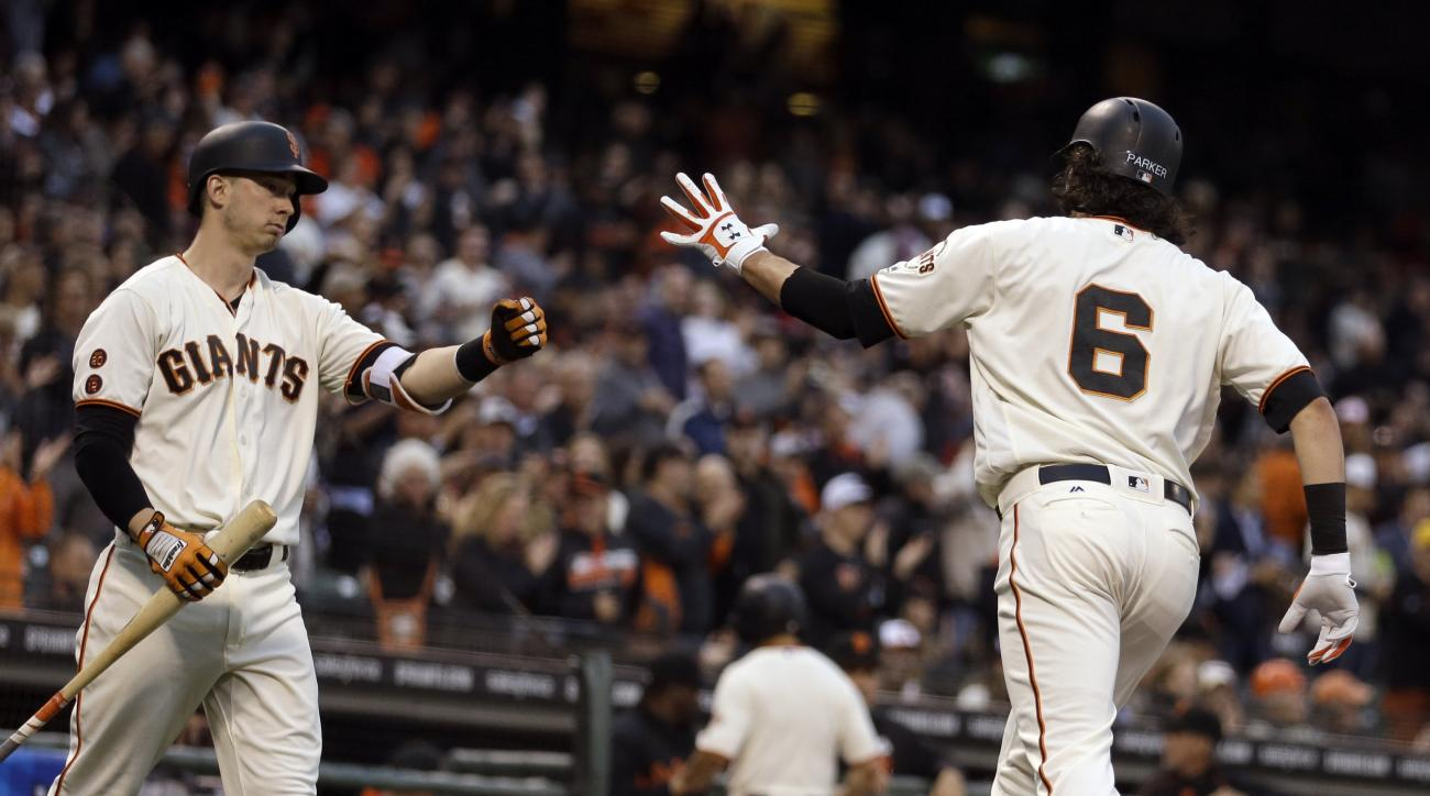 San Francisco Giants' Jarrett Parker, right, celebrates with Trevor Brown after hitting a home run off Boston Red Sox Rick Porcello in the third inning of a baseball game Tuesday, June 7, 2016, in San Francisco. (AP Photo/Ben Margot)