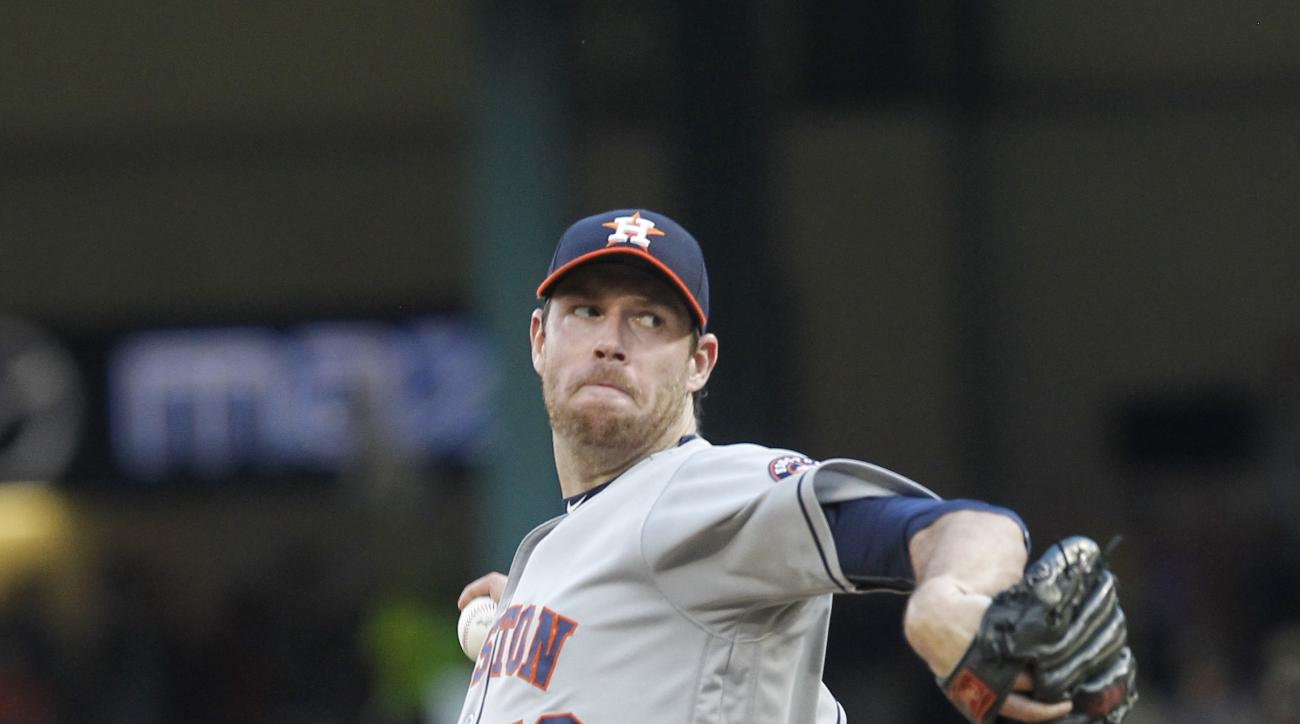 Houston Astros pitcher Doug Fister throws to a Texas Rangers batter during the first inning of a baseball game Wednesday, June 8, 2016, in Arlington, Texas. (AP Photo/Tim Sharp)
