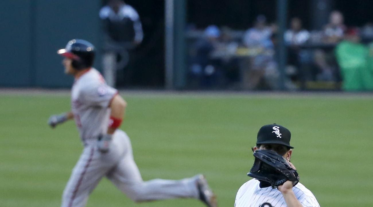 Chicago White Sox starting pitcher James Shields waits for a new ball after giving up a two-run home run to Washington Nationals' Ryan Zimmerman, left, during the first inning of a baseball game Wednesday, June 8, 2016, in Chicago. (AP Photo/Charles Rex A