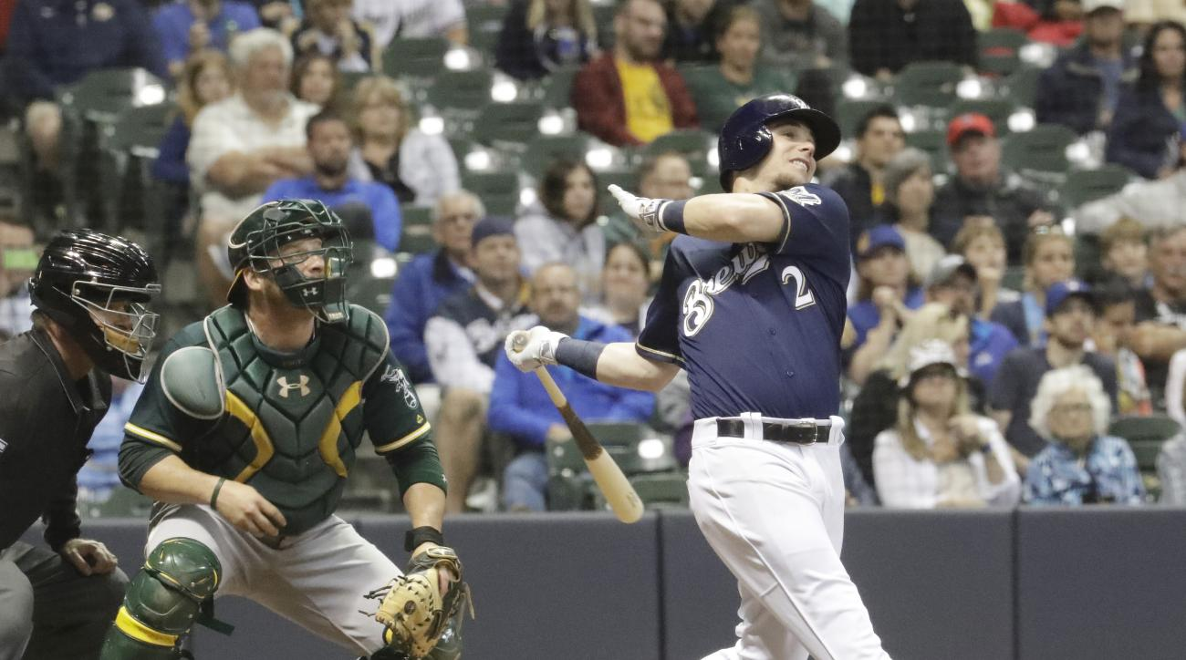 Milwaukee Brewers' Scooter Gennett hits a two-run scoring single during the fourth inning of a baseball game against the Oakland Athletics Wednesday, June 8, 2016, in Milwaukee. (AP Photo/Morry Gash)