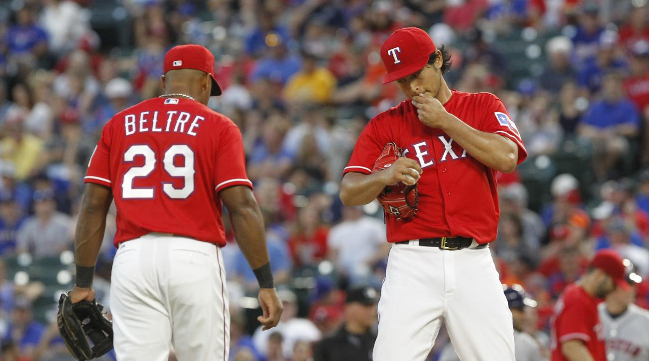 Texas Rangers third baseman Adrian Beltre (29) visits pitcher Yu Darvish (11) on the mound during the fifth inning of a baseball game against the Houston Astros on Wednesday, June 8, 2016, in Arlington, Texas. Darvish did not return to the game for the si