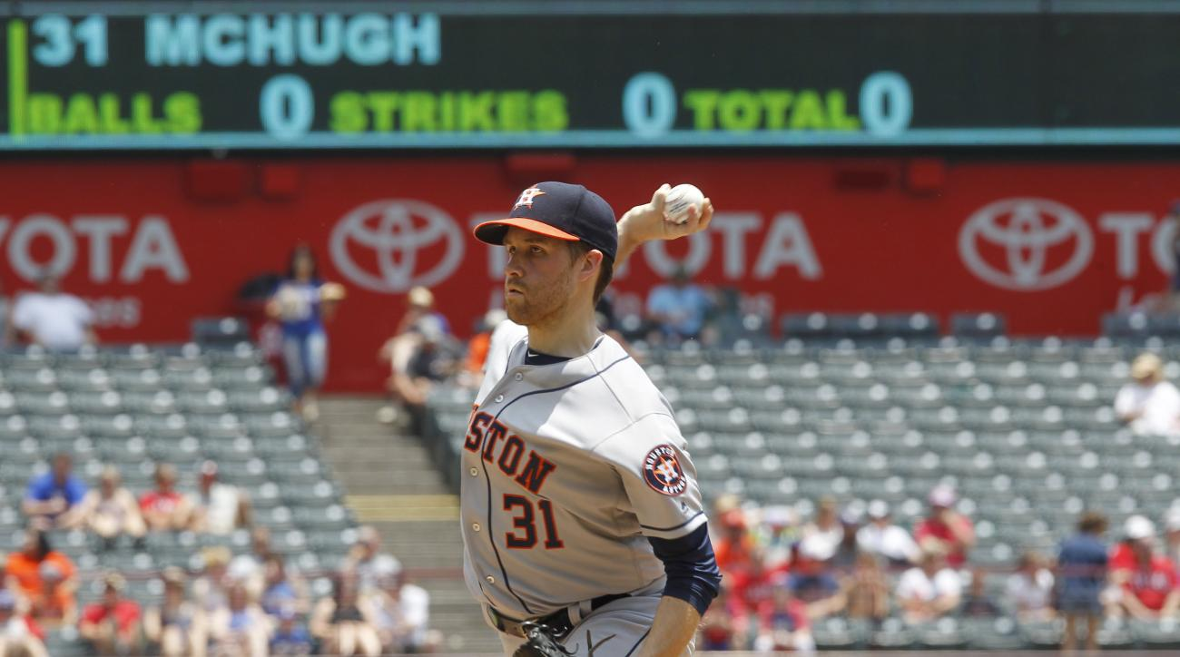 Houston Astros pitcher Collin McHugh throws against Texas Rangers batter Jurickson Profar in the first inning of a baseball game Thursday, June 9, 2016, in Arlington, Texas. (AP Photo/Tim Sharp)