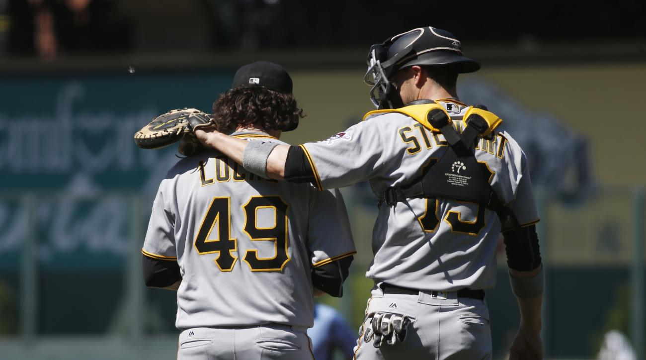 Pittsburgh Pirates catcher Chris Stewart, right, confers with starting pitcher Jeff Locke after he gave up a triple to Colorado Rockies' Ryan Raburn in the first inning of a baseball game Thursday, June 9, 2016, in Denver. (AP Photo/David Zalubowski)