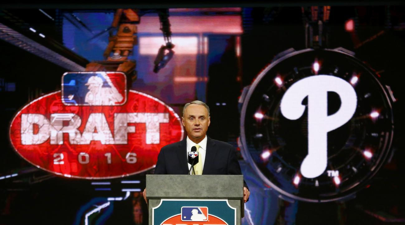 Baseball Commissioner Rob Manfred announces the No. 1 pick by the Philadelphia Phillies during the draft, Thursday, June 9, 2016, in Secaucus, N.J. The Phillies selected outfielder Mickey Moniak, of La Costa Canyon High School in Carlsbad, Calif., with th