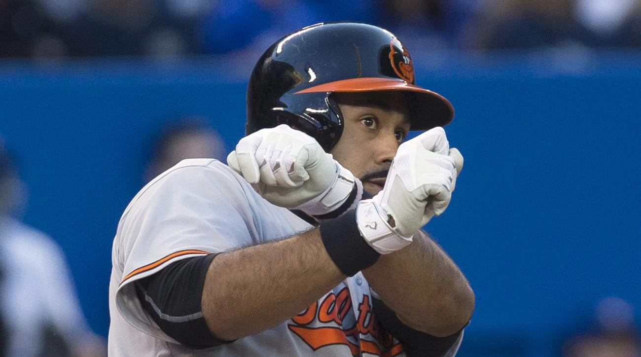 Baltimore Orioles' Pedro Alvarez watches his bat fly into the crowd during the third inning against the Toronto Blue Jays in a baseball game Thursday, June 9, 2016, in Toronto. (Chris Young/The Canadian Press via AP)