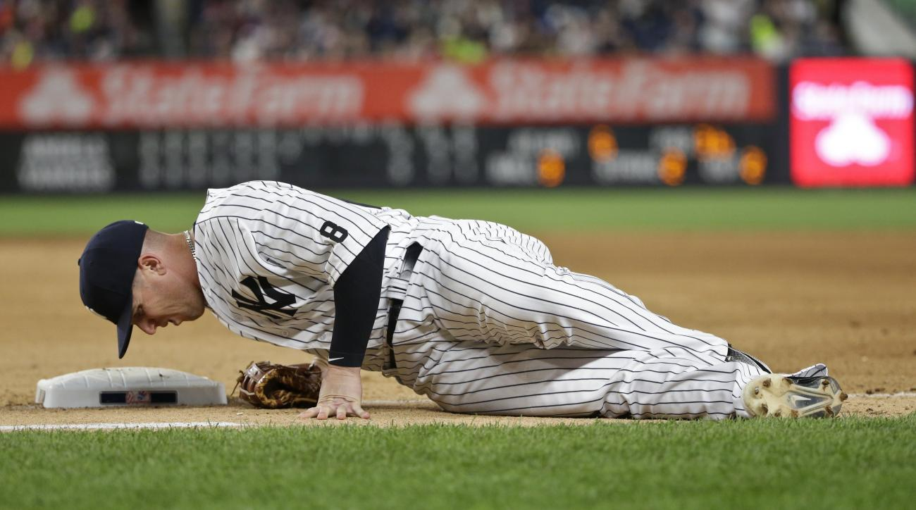 New York Yankees first baseman Chris Parmelee reacts after sustaining an injury during the seventh inning of a baseball game against the Los Angeles Angels on Thursday, June 9, 2016, in New York. (AP Photo/Frank Franklin II)