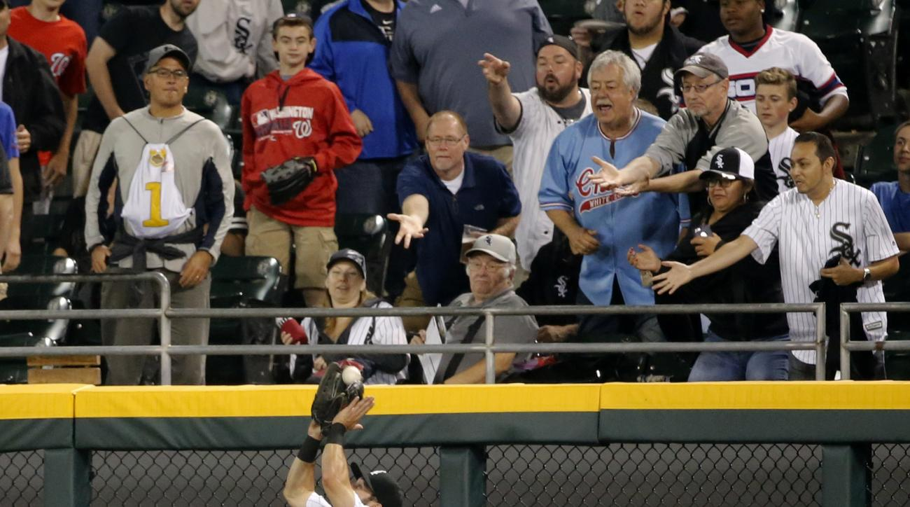 Chicago White Sox right fielder Adam Eaton catches a deep fly ball from Washington Nationals' Danny Espinosa during the eighth inning of a baseball game Thursday, June 9, 2016, in Chicago. (AP Photo/Charles Rex Arbogast)