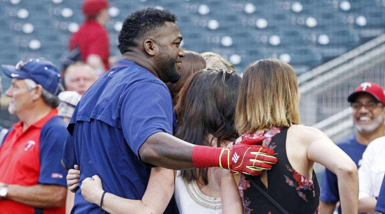 Boston Red Sox's David Ortiz poses with fans prior to a baseball game against the Minnesota Twins on Friday, June 10, 2016, in Minneapolis. Ortiz was to be honored by the Twins before the game as he makes his farewell tour before retiring at the end of th