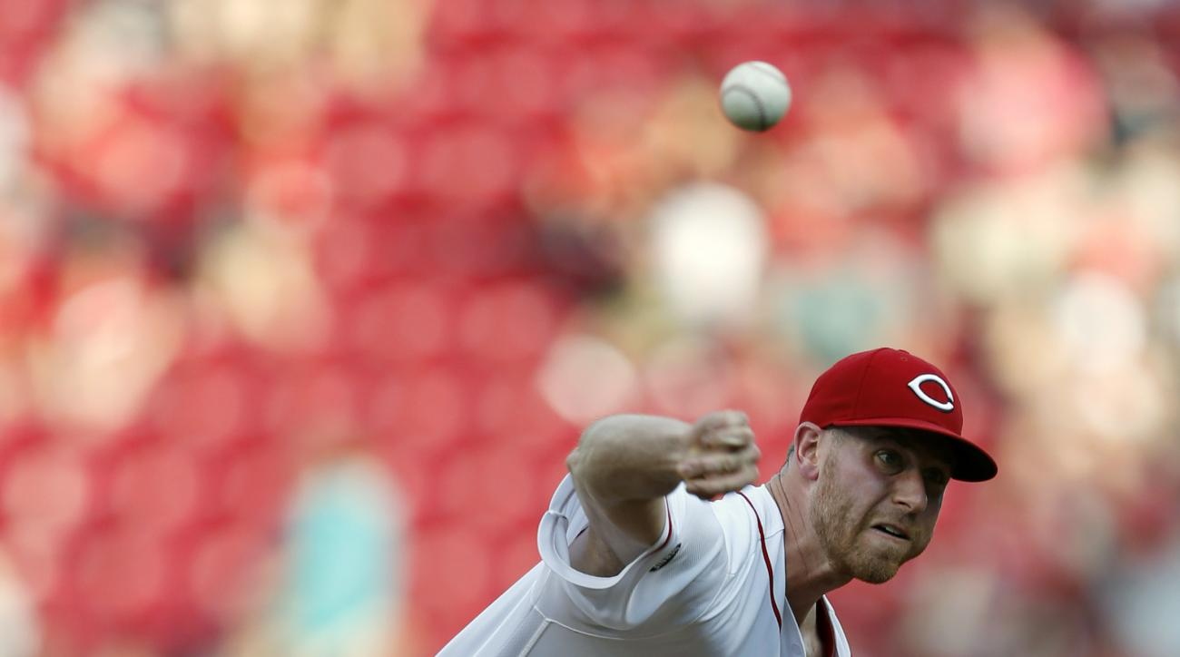 Cincinnati Reds starting pitcher Anthony DeSclafani (28) throws against the Oakland Athletics during the first inning of a baseball game, Friday, June 10, 2016, in Cincinnati. (AP Photo/Gary Landers)