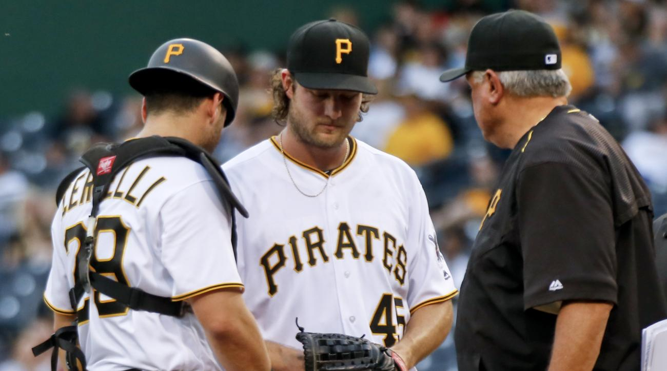 Pittsburgh Pirates starting pitcher Gerrit Cole center, talks with catcher Francisco Cervelli (29) and manager Clint Hurdle during the third inning of a baseball game against the St. Louis Cardinals, Friday, June 10, 2016, in Pittsburgh. Cole left the gam
