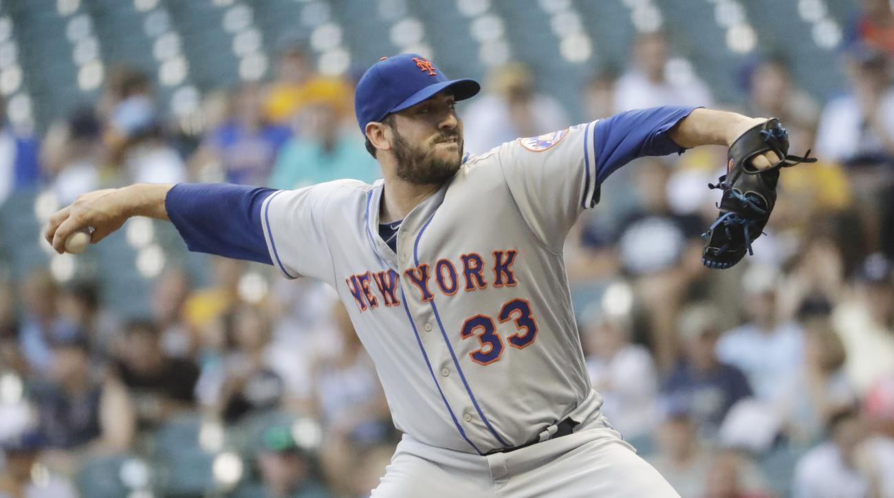 New York Mets starting pitcher Matt Harvey throws during the first inning of a baseball game against the Milwaukee Brewers Friday, June 10, 2016, in Milwaukee. (AP Photo/Morry Gash)