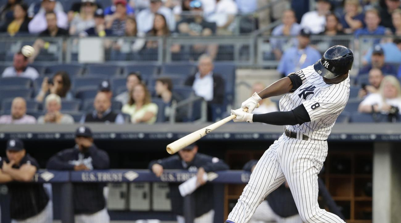 New York Yankees' Didi Gregorius hits a two-run double during the first inning of a baseball game against the Detroit Tigers on Friday, June 10, 2016, in New York. (AP Photo/Frank Franklin II)