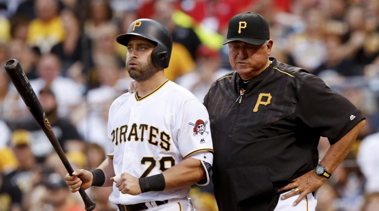 Pittsburgh Pirates' Francisco Cervelli stands with manager Clint Hurdle after suffering an injury while batting against the St. Louis Cardinals during the fourth inning of a baseball game, Friday, June 10, 2016, in Pittsburgh. Cervelli left the game and w