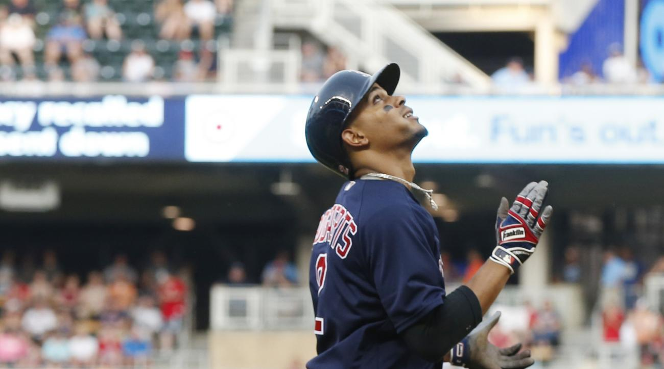 Boston Red Sox Xander Bogaerts looks skyward as he heads home on a three-run home run off Minnesota Twins pitcher Tyler Duffey in the fifth inning of a baseball game Friday, June 10, 2016, in Minneapolis. (AP Photo/Jim Mone)