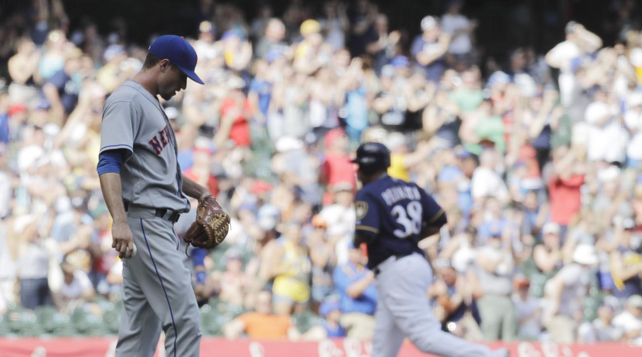 New York Mets relief pitcher Logan Verrett looks down after giving up a two-run home run to Milwaukee Brewers' Wily Peralta (38) during the fourth inning of a baseball game Saturday, June 11, 2016, in Milwaukee. (AP Photo/Morry Gash)