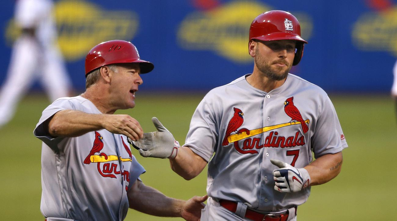 St. Louis Cardinals' Matt Holliday, right, rounds third to greetings from coach Chris Maloney after hitting a three run home run off Pittsburgh Pirates starting pitcher Francisco Liriano during the fifth inning of a baseball game in Pittsburgh, Saturday,