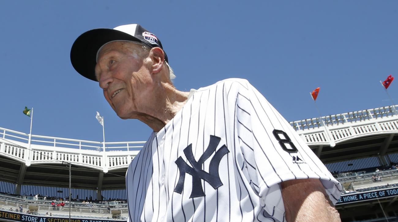 Dr. Bobby Brown, 91, a third baseman and former president of the American League, traverses the field before the Yankees annual Old Timers Day baseball game, Sunday, June 12, 2016, in New York. (AP Photo/Kathy Willens)