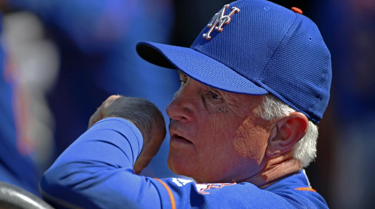 FILE - In this Tuesday, June 7, 2016 file photo, New York Mets manager Terry Collins stands in the dugout before a baseball game against the Pittsburgh Pirates in Pittsburgh. Collins was being taken to a hospital on Sunday, June 12, for precautionary test