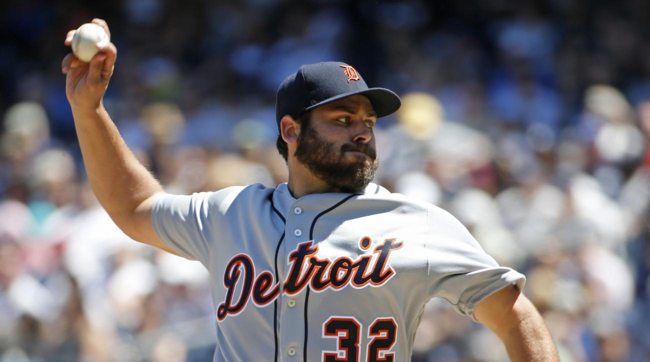 Detroit Tigers starting pitcher Michael Fulmer (32) delivers during the first inning of a baseball game against the New York Yankees, Sunday, June 12, 2016, in New York. (AP Photo/Kathy Willens)