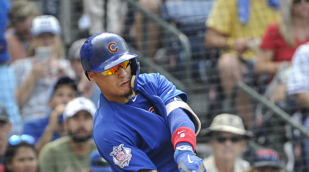 Chicago Cubs' Javier Baez connects with a pitch to put it over the left field wall for a three-run home run against the Atlanta Braves during the eighth inning of a baseball game, Sunday, June, 12, 2016, in Atlanta. (AP Photo/John Amis)