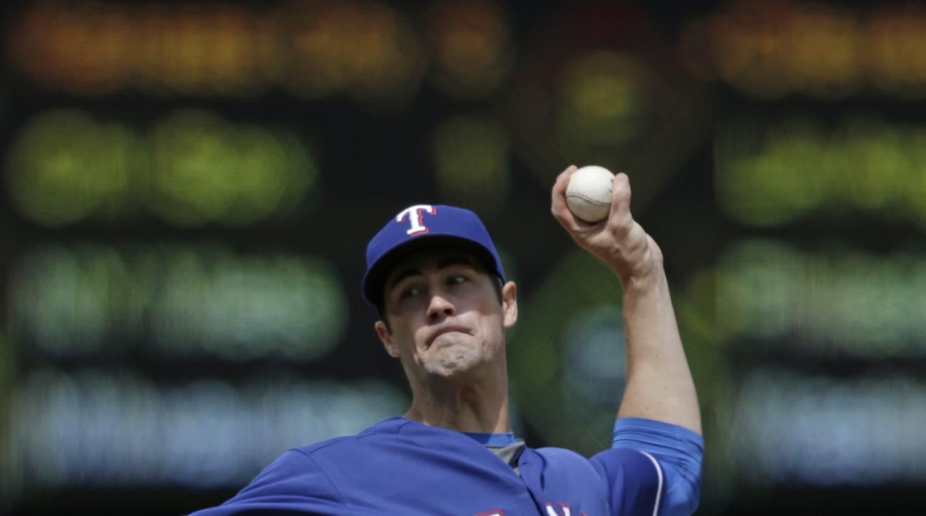 Texas Rangers starting pitcher Cole Hamels works against the Seattle Mariners during the third inning of a baseball game Sunday, June 12, 2016, in Seattle. (AP Photo/John Froschauer)