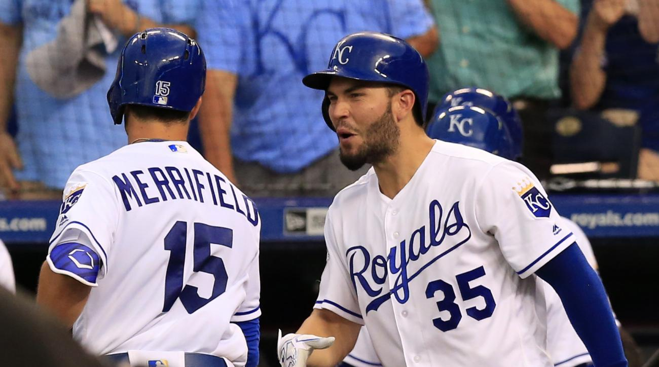 Kansas City Royals' Whit Merrifield (15) is congratulated by Eric Hosmer (35) after his solo home run off Cleveland Indians starting pitcher Carlos Carrasco during the fourth inning of a baseball game at Kauffman Stadium in Kansas City, Mo., Monday, June
