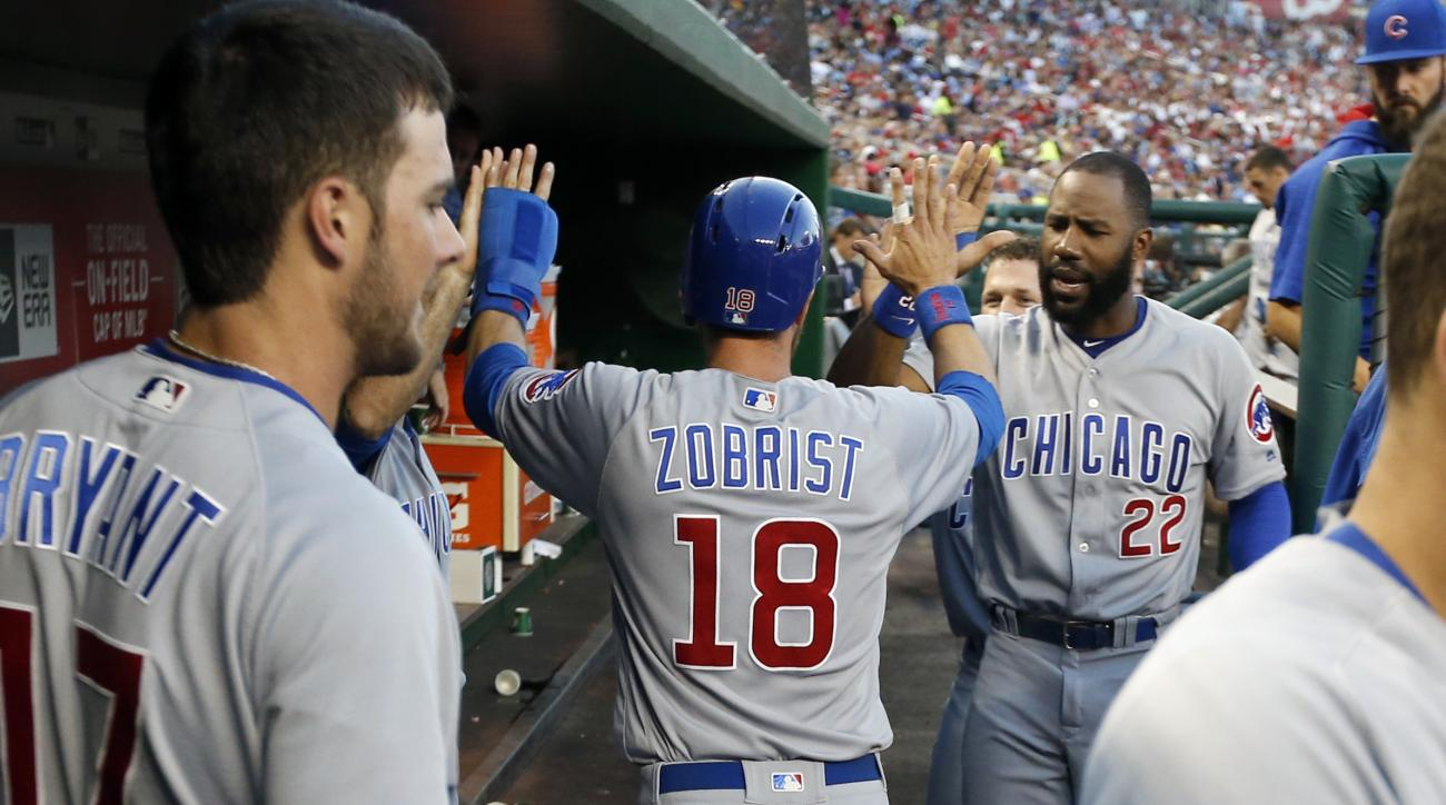 Chicago Cubs' Ben Zobrist (18) celebrates with teammates after scoring during the fourth inning of a baseball game against the Washington Nationals at Nationals Park, Tuesday, June 14, 2016, in Washington. (AP Photo/Alex Brandon)