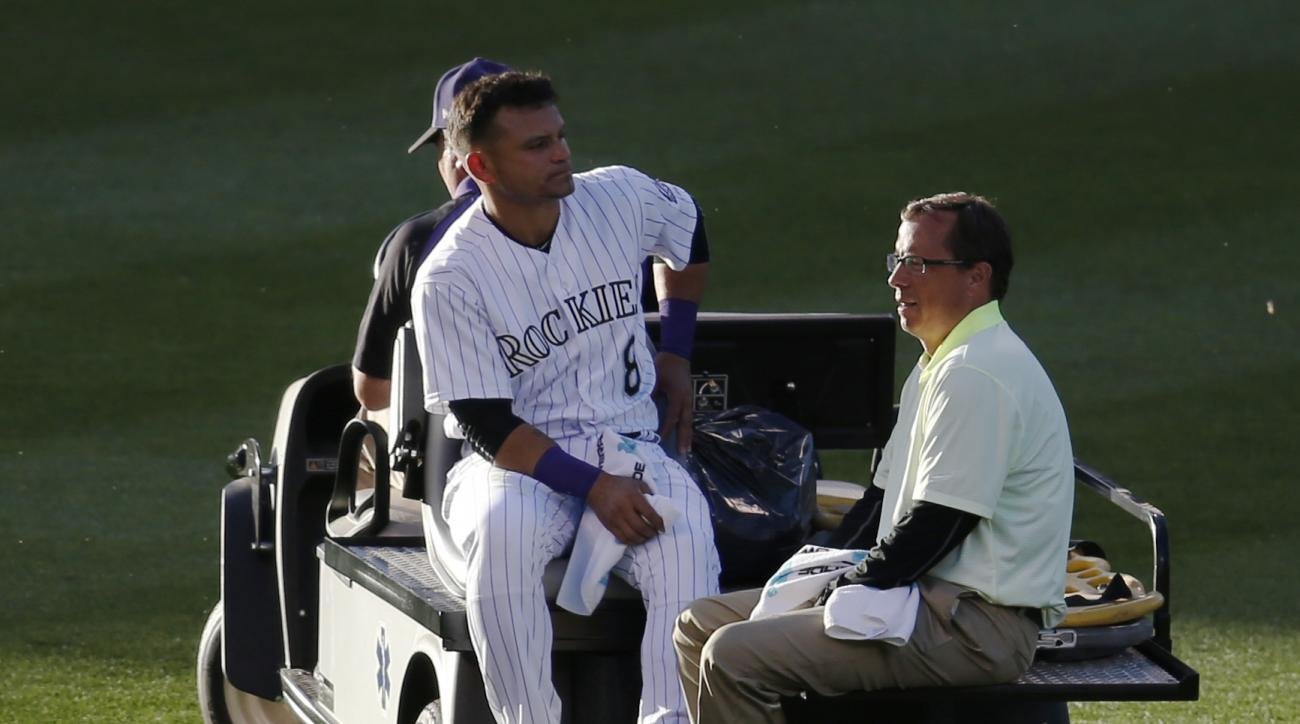 Colorado Rockies left fielder Gerardo Parra is carted off the field after injuring his leg when he collided with shortstop Trevor Story while pursuing a fly ball off the bat of New York Yankees' Jacoby Ellsbury in the top of the third inning of a baseball