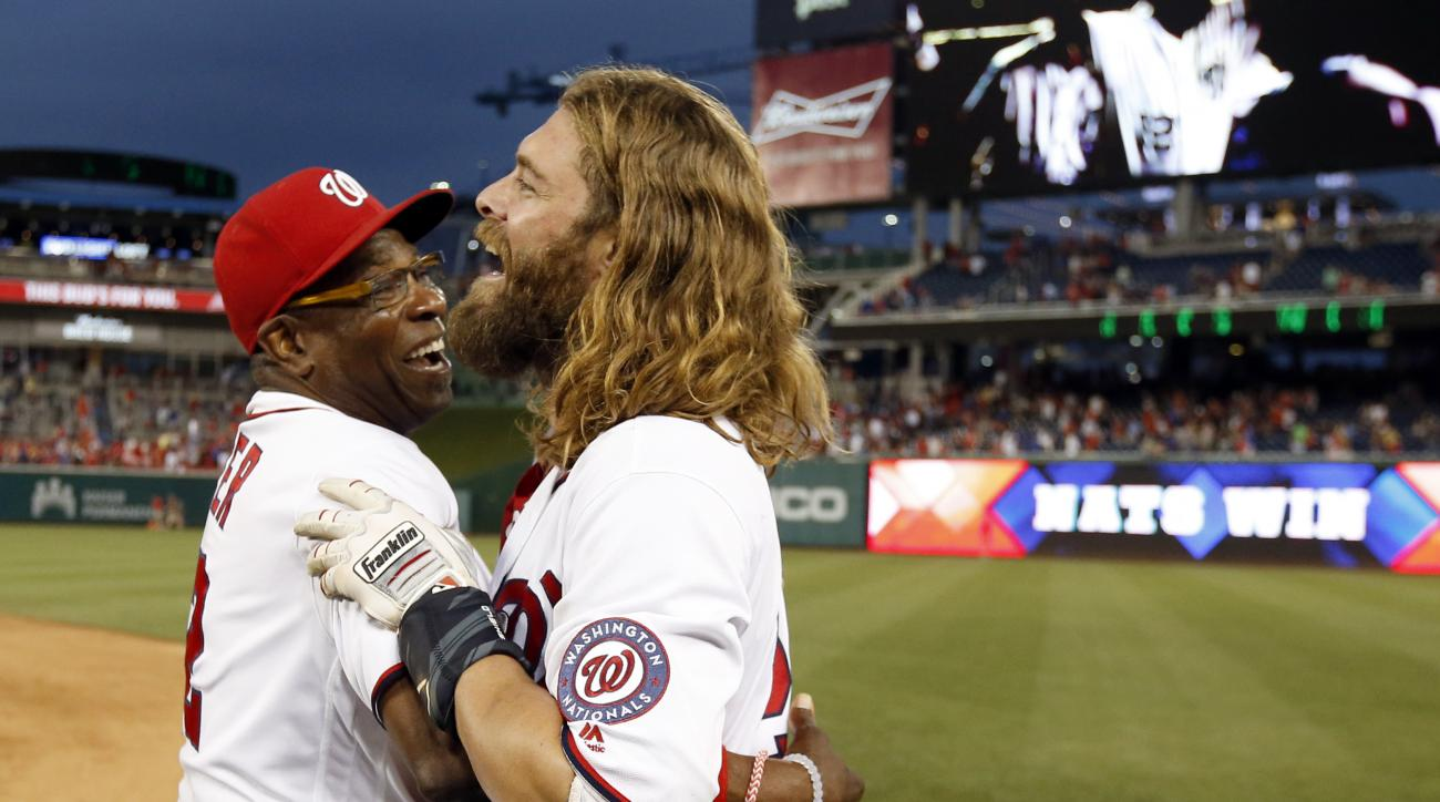 Washington Nationals manager Dusty Baker, left, celebrates with Jayson Werth after a baseball game against the Chicago Cubs at Nationals Park, Wednesday, June 15, 2016, in Washington. Werth hit the game-winning RBI single. The Nationals won 5-4, in 12 inn