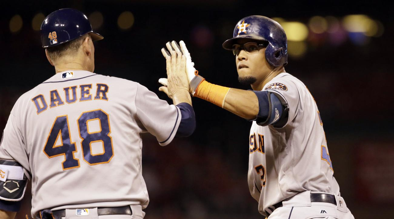 Houston Astros' Carlos Gomez, right, is congratulated by first base coach Rich Dauer after hitting a two-run single during the ninth inning of a baseball game Wednesday, June 15, 2016, in St. Louis. (AP Photo/Jeff Roberson)
