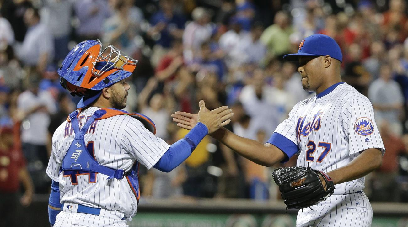 New York Mets catcher Rene Rivera (44) and pitcher Jeurys Familia (27) shake hands after the Mets beat the Pittsburgh Pirates 11-2 in a baseball game, Wednesday, June 15, 2016, in New York. (AP Photo/Julie Jacobson)