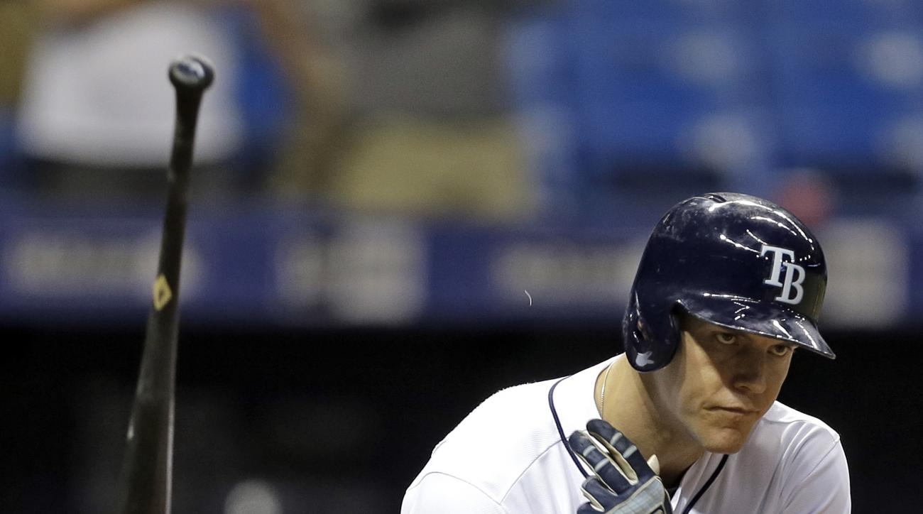 Tampa Bay Rays' Logan Morrison flings his bat as he draws a bases loaded walk from Seattle Mariners relief pitcher Mike Montgomery during the 13th inning of a baseball game Wednesday, June 15, 2016, in St. Petersburg, Fla. The Rays won the game 3-2. (AP P
