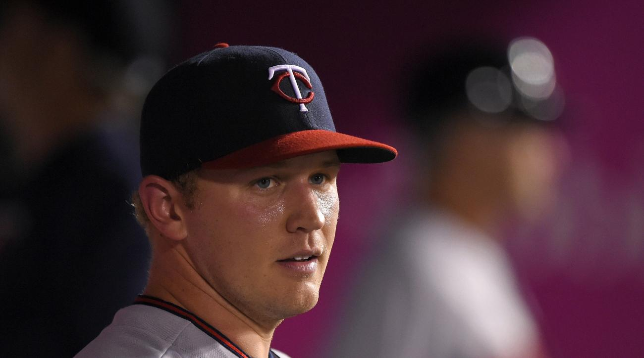 Minnesota Twins starting pitcher Tyler Duffey stands in the dugout after being taken out of the game during the fifth inning of a baseball game against the Los Angeles Angels, Wednesday, June 15, 2016, in Anaheim, Calif. (AP Photo/Mark J. Terrill)