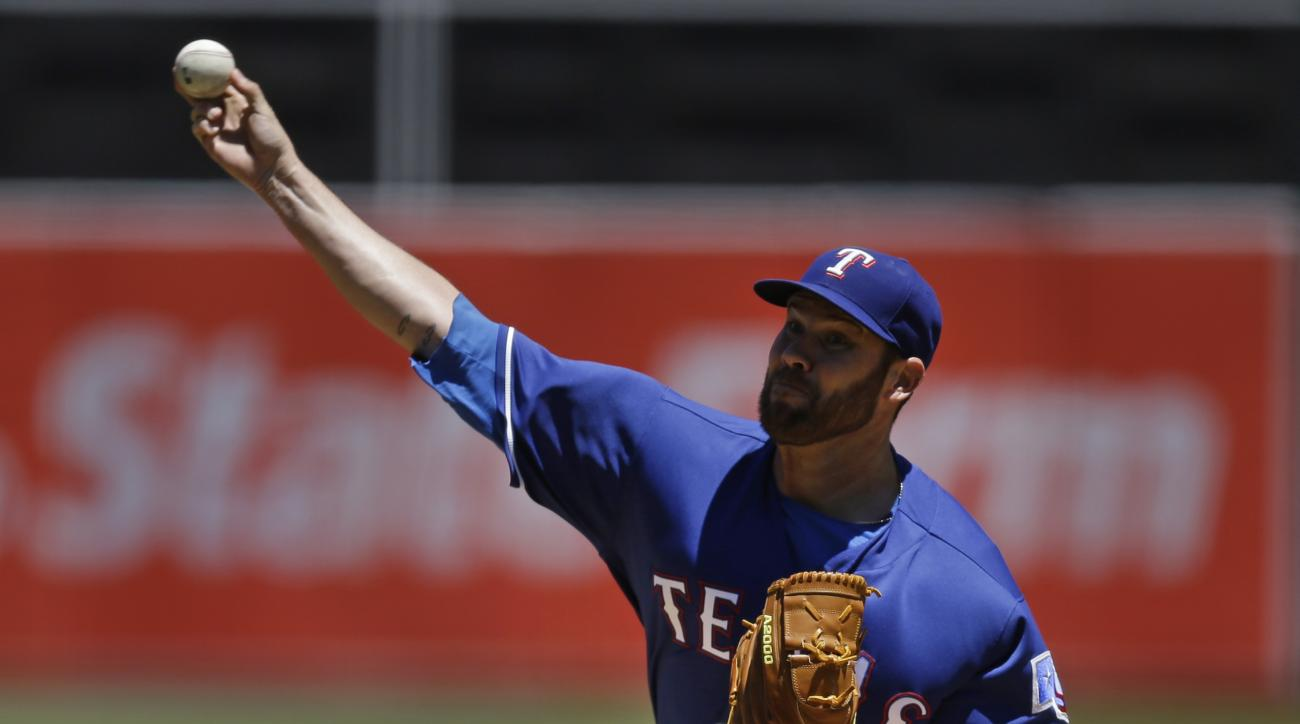 Texas Rangers pitcher Colby Lewis works against the Oakland Athletics in the first inning of a baseball game Thursday, June 16, 2016, in Oakland, Calif. (AP Photo/Ben Margot)