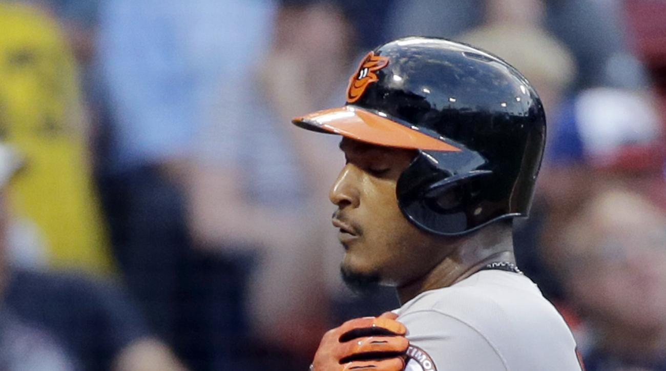 Baltimore Orioles' Adam Jones touches his patch as he crosses home plate after his two-run home run in the third inning of a baseball game against the Boston Red Sox at Fenway Park on Thursday, June 16, 2016, in Boston. (AP Photo/Elise Amendola)