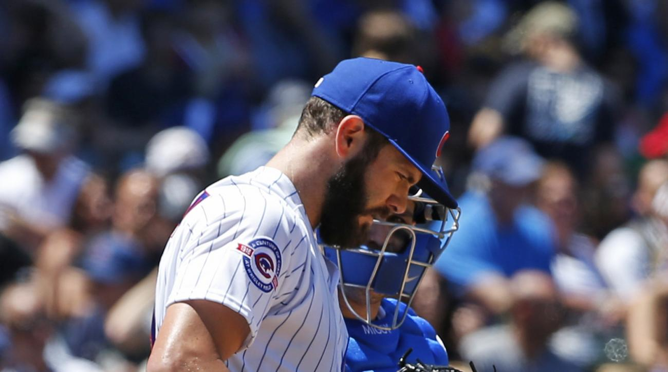 Chicago Cubs starter Jake Arrieta, left, listens to catcher Miguel Montero during the third inning of a baseball game against the Pittsburgh Pirates, Friday, June 17, 2015, in Chicago. (AP Photo/Nam Y. Huh)